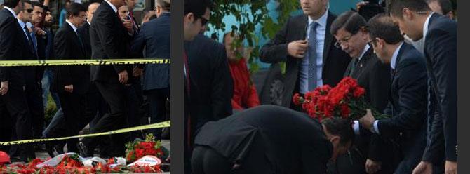 Başbakan Davutoğlu saldırı noktasına karanfil bıraktı