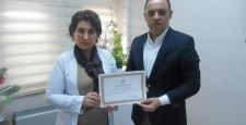 Sağlık Bakanı Müezzinoğlu'ndan Demir'e takdir belgesi